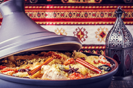 meal: Traditional moroccan tajine of chicken with dried fruits and spices, selective focus.