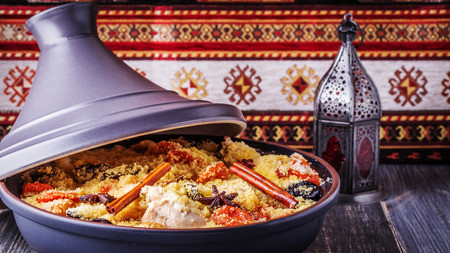Traditional moroccan tajine of chicken with dried fruits and spices, selective focus. Reklamní fotografie - 47543719