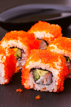 makki: Sushi roll with crab, avocado, cucumber and tobiko, selective focus.
