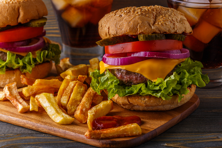 hamburger: Burger, hamburger with french fries and fresh vegetables on a dark wooden background.