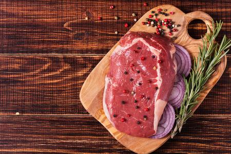 seasoning: Raw fresh meat Ribeye Steak, seasoning  on dark background.