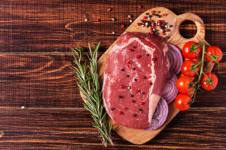 Raw fresh meat Ribeye Steak, seasoning  on dark background.