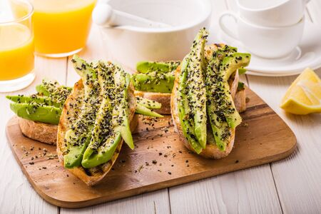 ciabatta: Avocado sandwich on ciabatta bread made with fresh sliced avocados. Stock Photo