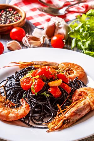 pasta: Black spaghetti with prawns and tomato garlic sauce.