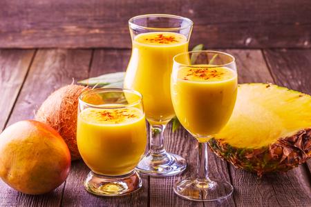 Tropical milkshake with ingredients, selective focus.