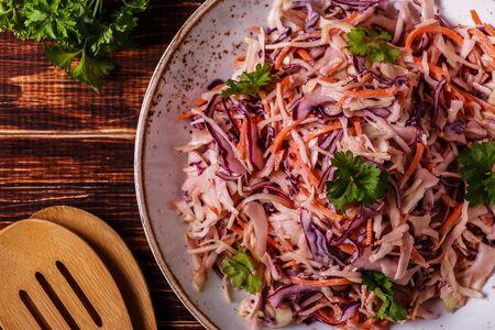 Homemade coleslaw in bowl on dark wooden background. Banco de Imagens