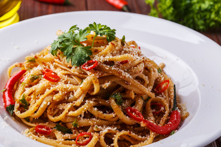 Homemade linguine pasta in arrabbiata sauce, served with parmesan and parsley.