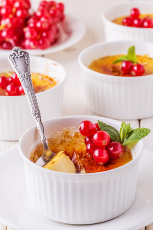 traditionally french: Creme brulee - traditional french vanilla cream dessert with caramelised sugar on top. Stock Photo