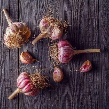 garlic: Garlic on wooden vintage background, top view. Stock Photo