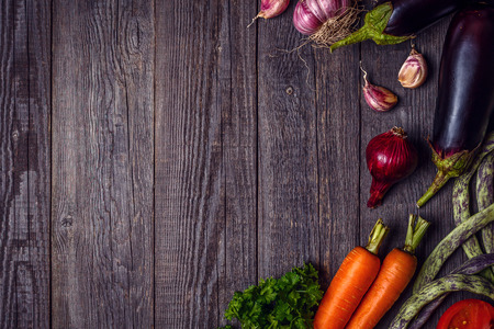 Fresh vegetables for cooking on dark wooden background with space for text. Top view. Concept of healthy, vegetarian, diet food. Stock Photo