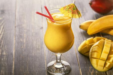 tropical drink: Mango smoothie, selective focus. Detox, diet food, vegetarian food, healthy eating concept.