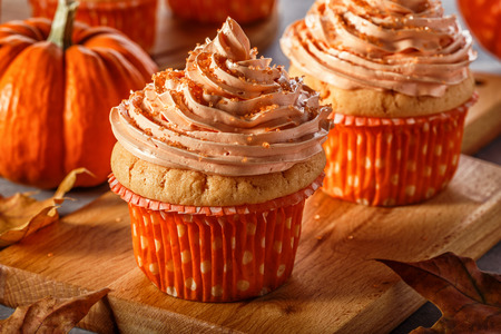 pastrie: Pumpkin cupcakes with glitter sugar sprinkles, selective focus.