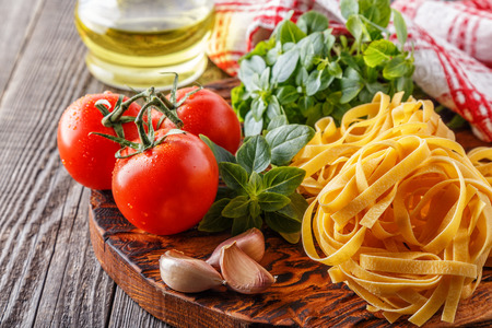 Cutting board with ingredients - concept of Italian cuisine. Stock Photo