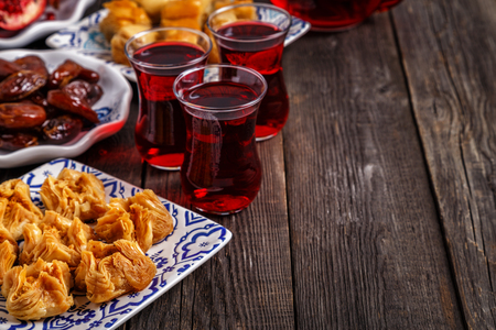 Oriental sweets with hibiscus tea in assortment, selective focus, copy space. Stock Photo