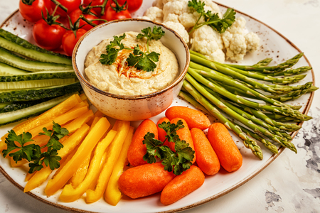 Healthy homemade hummus with assorted fresh vegetables. Concept of healthy, vegetarian, diet food.