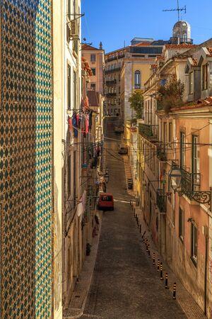 bairro: Narrow street of Lisbon Bairro Alto district, Portugal. Stock Photo