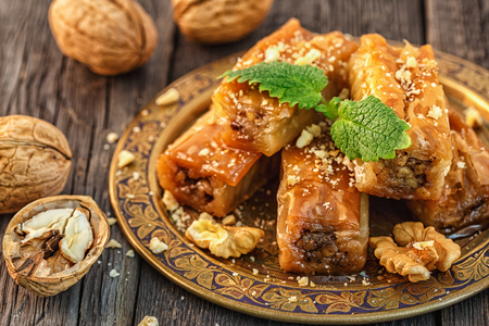 Traditional arabic dessert Baklava with honey and walnuts, selective focus. Stock Photo