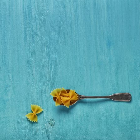 Concept of food, pasta on a blue background, top view, banner. Stock Photo