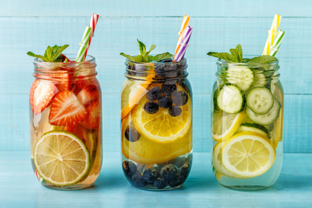 Detox fruit infused water. Refreshing summer homemade cocktail, selective focus. Stock Photo