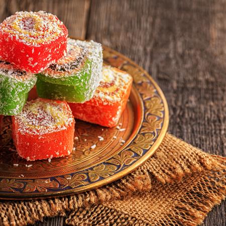 gelatina: Turkish delight on dark wooden background,  selective focus. Foto de archivo