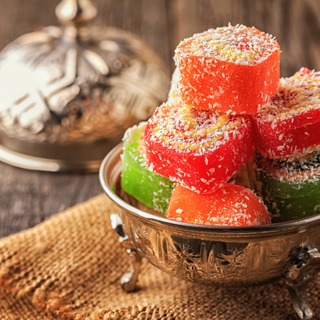 Turkish delight on dark wooden background,  selective focus. Stock Photo
