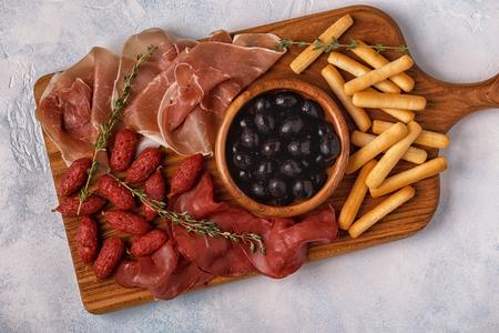 gressins: Sausage olives prosciutto breadsticks wine.
