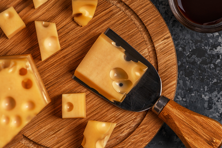 Cheese on cutting board, top view, copy spase.