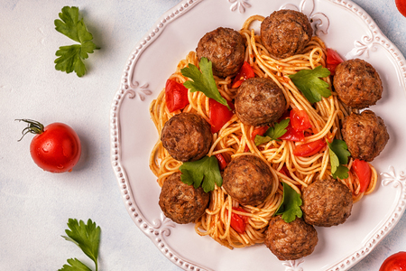 Roasted  meatballs with spaghetti. Top view, copy space. Stock Photo - 85420102