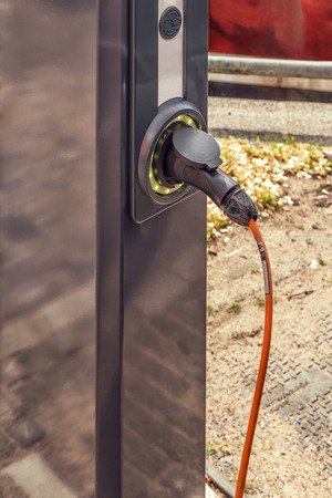 Electro mobile charging station, selective focus. Фото со стока