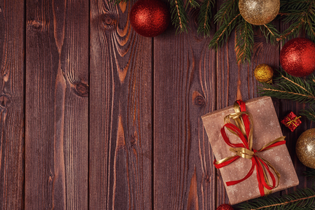 Christmas gift boxes and fir tree  on wooden background. Top view with copy space Imagens