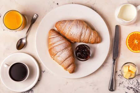 Delicious breakfast with fresh croissants. Top view. Stock fotó