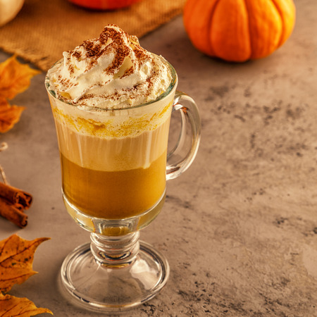 Pumpkin spice latte with whipped cream, selective focus.