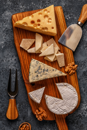 Assorted cheeses on wooden board, top view, copy space. Stock fotó
