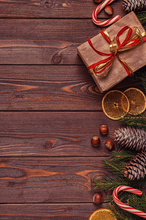 Christmas gift boxes and fir tree  on wooden background. Top view with copy space Banco de Imagens - 88033380