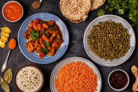 Traditional Indian curry with lentils, mung beans. Top view. Stock Photo