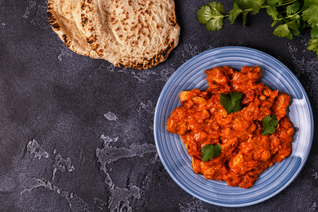 Traditional Indian curry with chicken. Top view, copy space.