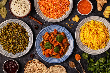 Traditional Indian curry with rice, lentils and mung beans. Top view. Stock Photo - 88141787