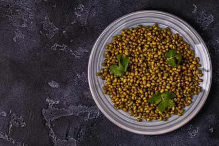 Mung beans with spices. Top view, copy space.