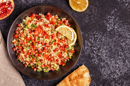Tabbouleh salad, traditional middle eastern or arab dish. Top view, copy space.