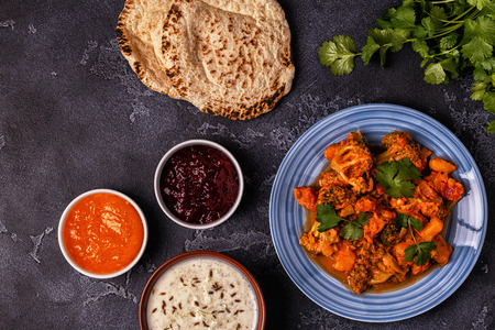 Traditional Indian curry with vegetables. Top view, copy space. Stock Photo