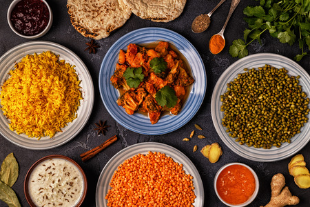 Traditional Indian curry with rice, lentils and mung beans. Top view. Stock Photo