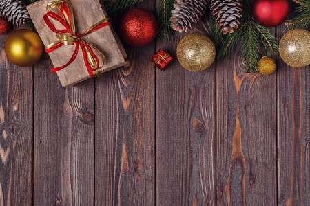 Christmas gift boxes and fir tree  on wooden background. Top view with copy space Banco de Imagens - 88142530