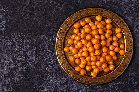 Cooked chickpeas on a plate, top view, copy space. Stock Photo