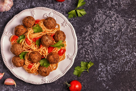 Roasted  meatballs with spaghetti. Top view, copy space. Stock Photo - 89790549
