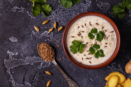 Traditional Indian Raita with cucumber, cumin, coriander. Top view, copy space. Stock Photo