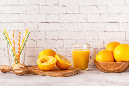 Oranges and juicer for making orange juice. Copy space. Stock Photo