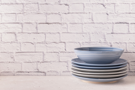 Crockery  on a light table with copy space. Stock Photo