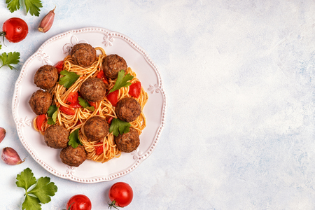 Roasted  meatballs with spaghetti. Top view, copy space. Stock Photo - 90947039