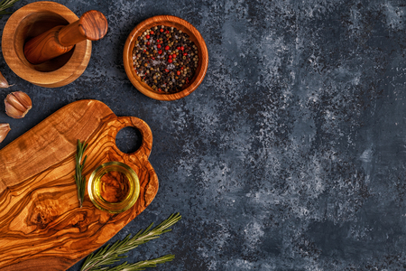 Cutting board and spice for cooking on a dark background.