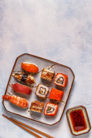 Sushi Set: sushi and sushi rolls on plate, top view.